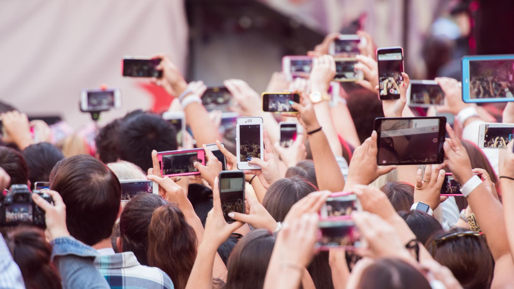 Photo of cellphones with a crowd